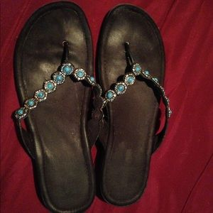 Minnetonka turquoise and silver flip flops